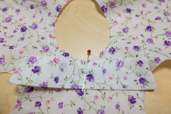 Begin to sew the collar on the neckline